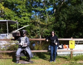 Katherine Quevedo with bayou pirate statue